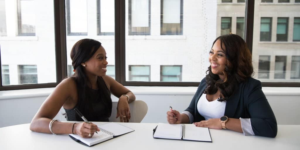 two women in discussion