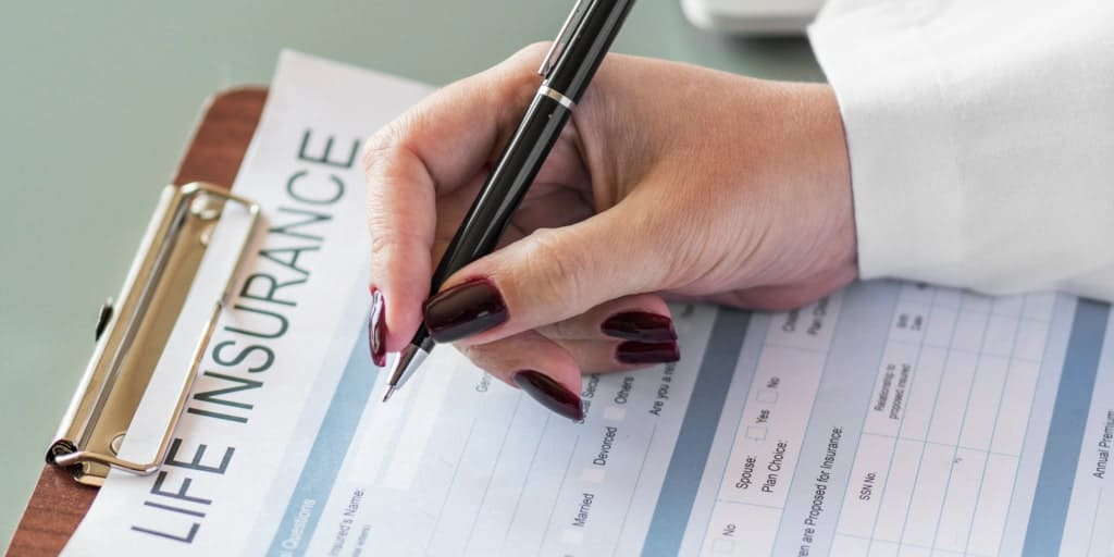 woman completing a life insurance application form