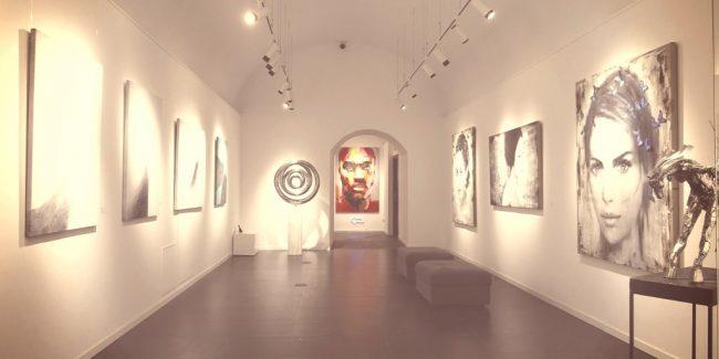 fine art hanging in a lit gallery