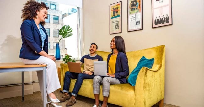 female business owner meeting with two employees