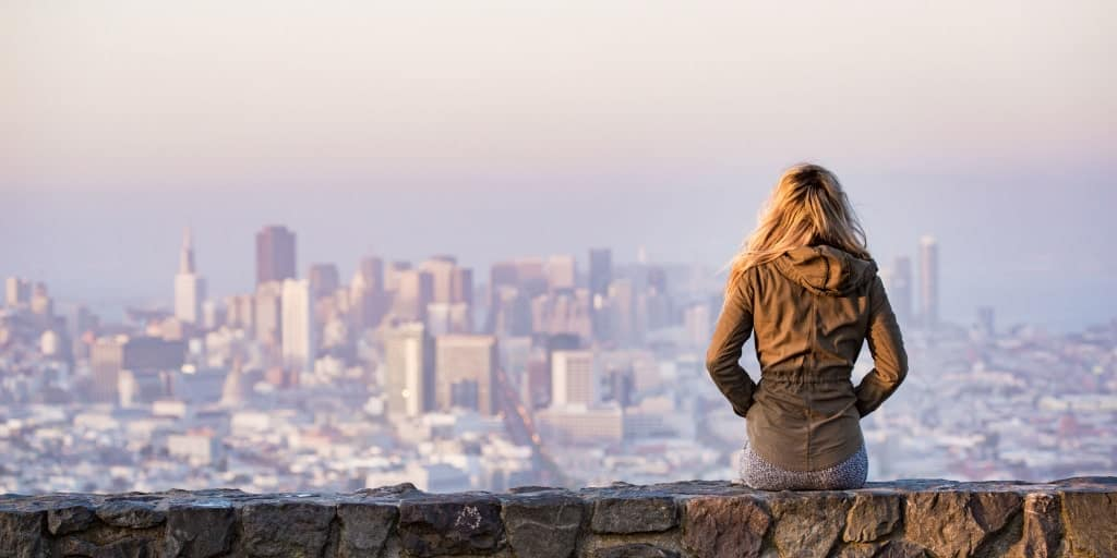 woman looking at a vast city landscape from a view above