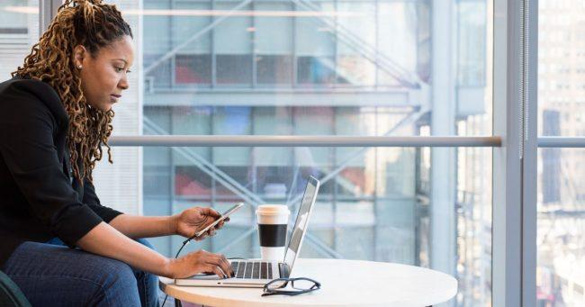 female working on her side hustle on laptop