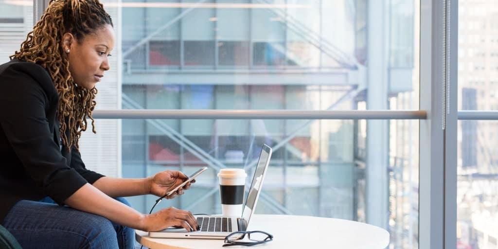 female researching side hustle ideas on laptop