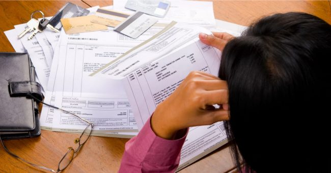 women looking at debt collection letters