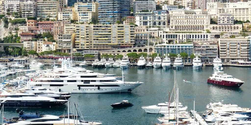 boats and yachts of the rich and wealthy docked in a bay