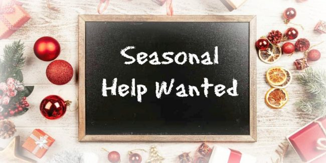 seasonal help wanted sign looking for workers who want a seasonal job to earn extra money