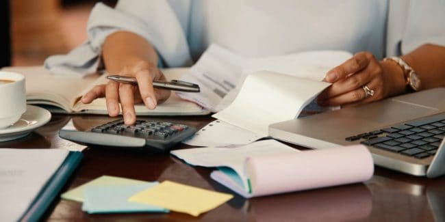 female reviewing financial and tax documents