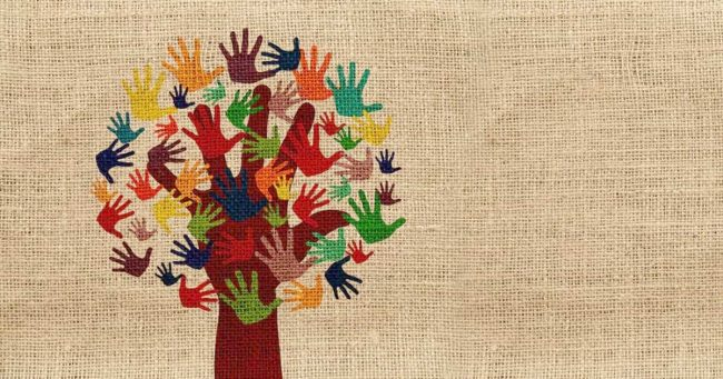 graphic giving tree made from colored handprints