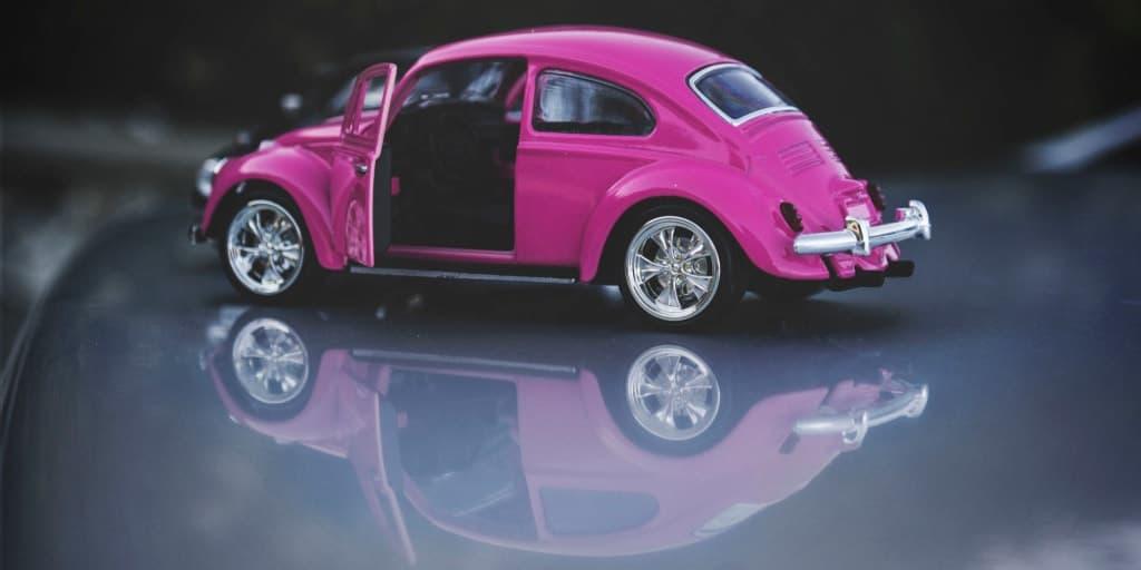 model of a pink volkswagen beetle car
