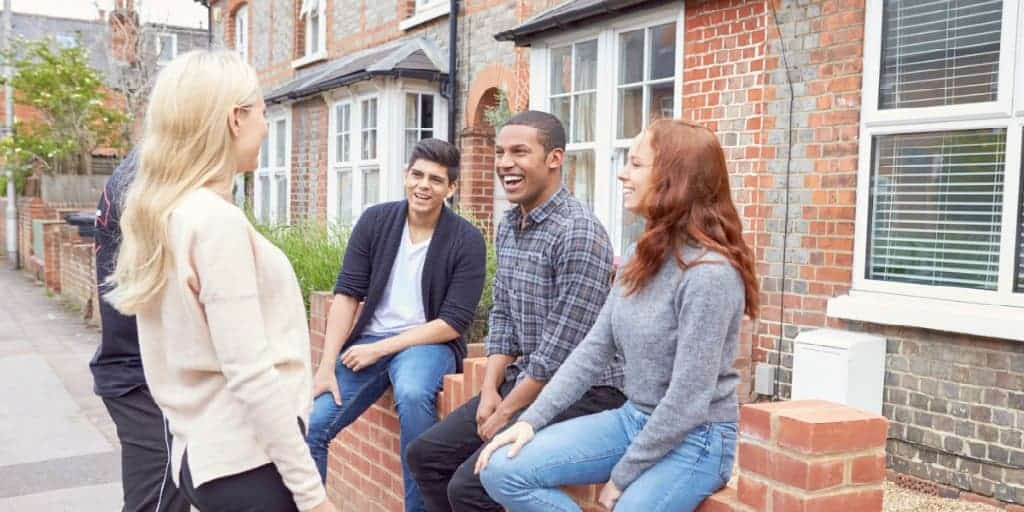 college students outside rental house