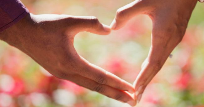 couple joining hands into a heart