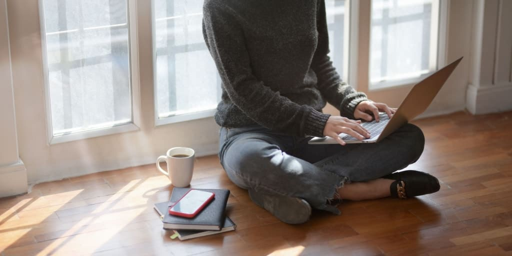 female working on laptop organizing drive files