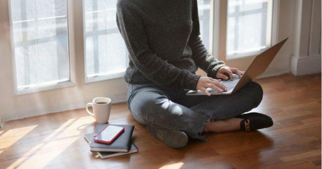 female organizing digital files on laptop