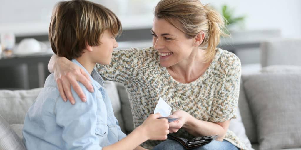 mom giving son allowance money