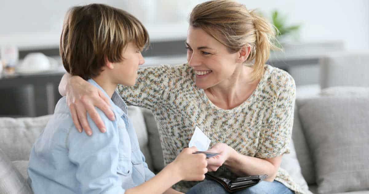 woman giving son allowance money