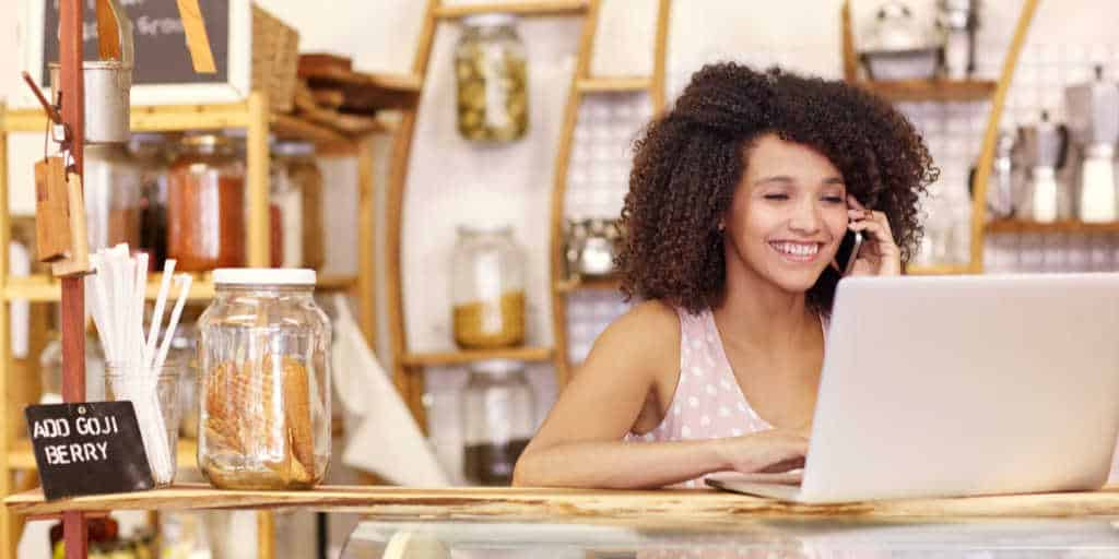 women working part time at a coffee shope while growing her business