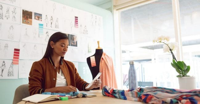 female entrepreneur solving issues in her shop