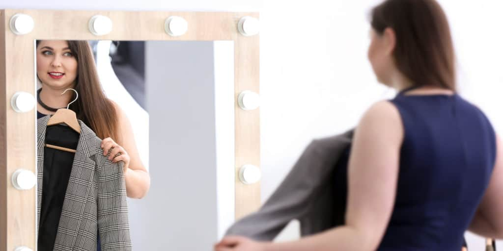 woman trying on clothes for work wardrobe