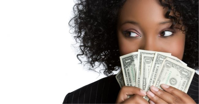 young black women fanning money in front of her face