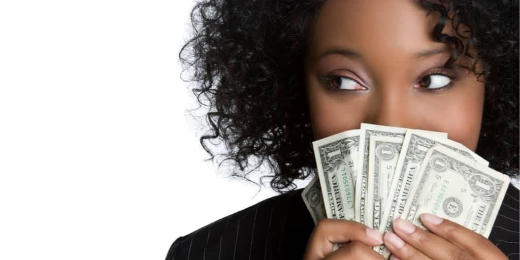 Young black women having fun with money