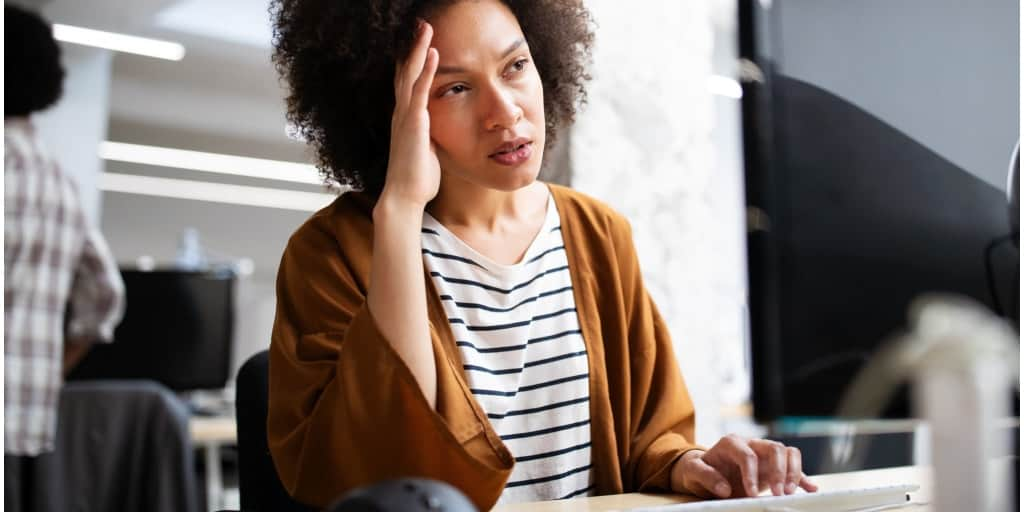 woman stressed at work and ready to quit her job