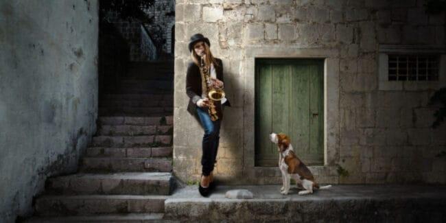 Sunday night blues female sax player and dog