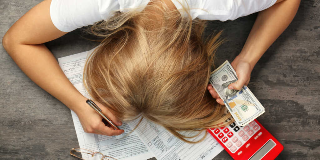 woman tired of calculating her taxes