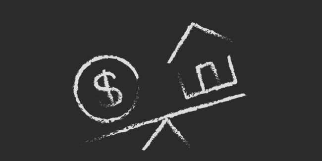 chalk drawn money symbol and house on a tipping scale depicting the mistake of paying to much money when buying a home