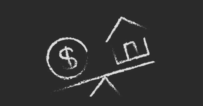 dollar symbol and house on a tipping scale drawn in chalk
