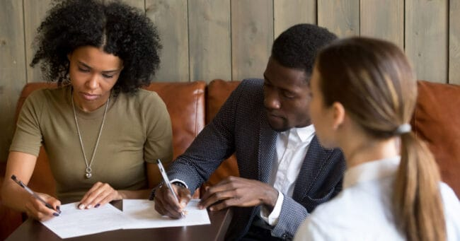 black couple making a real estate purchase offer (1)