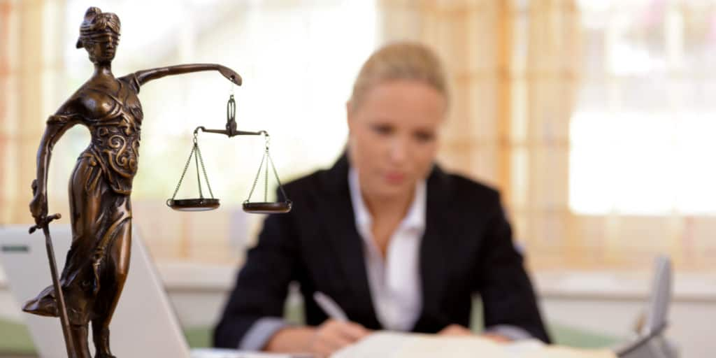 a young lawyer is sitting at her desk in the office