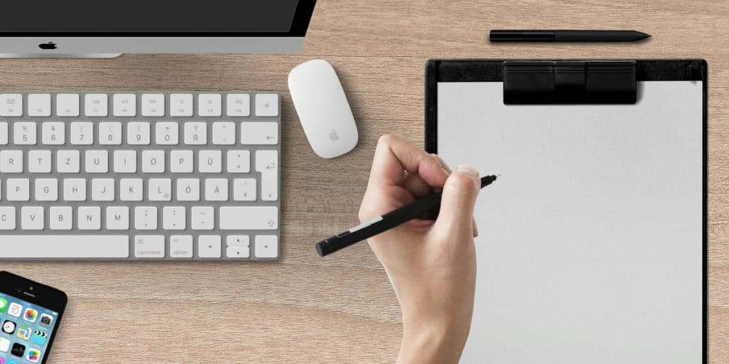 freelance writer taking notes to be successful