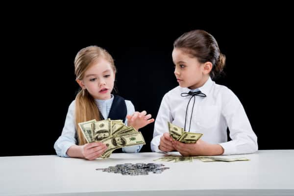 young girls playing with money