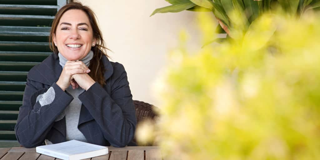 smiling single woman reading financial book