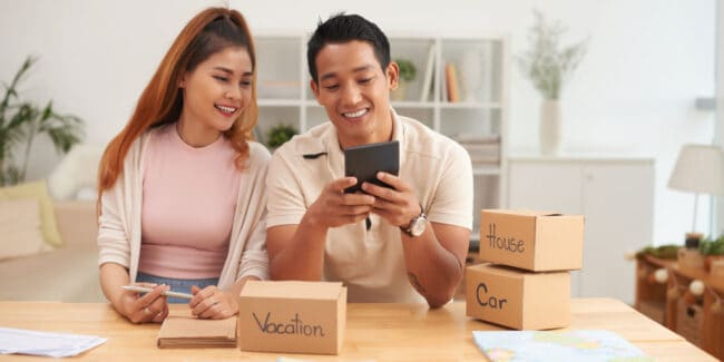 young couple budgeting for savings goals