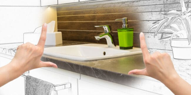 Female hands framing custom bathroom remodel. Combination drawing and photo.