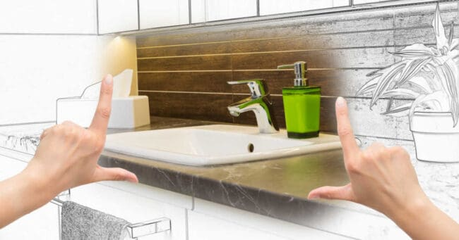 Female hands framing custom bathroom redesign. Combination drawing and photo.