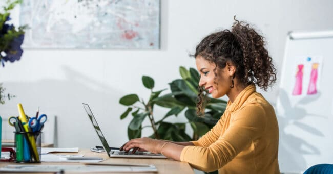 young woman working smart on her laptop