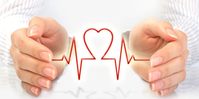 female hands around heart symbol representing a health care sharing ministry concept