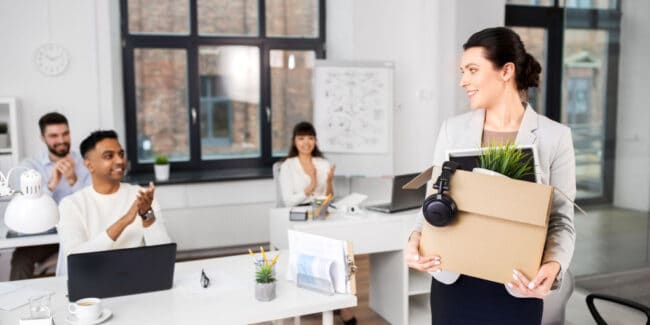 three employees welcoming new female employee