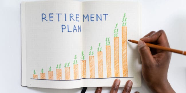 african american woman drawing graph depicting retirement savings progress