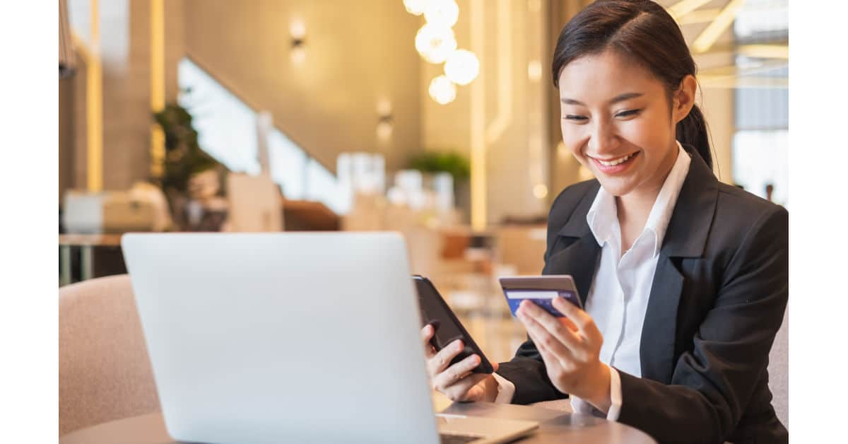 young businesswoman using credit card