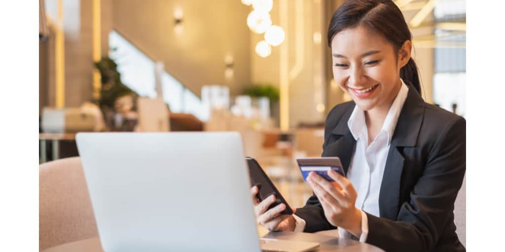 young woman using business credit card