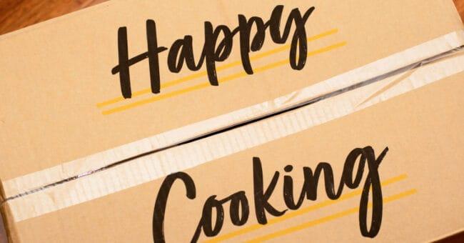 happy cooking written on cardboard box