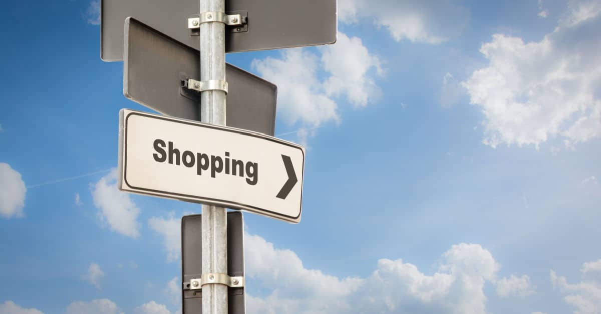 Street Sign pointing the Direction to Shopping